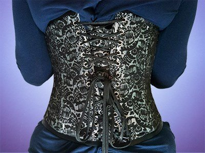 A picture of the back of someone wearing a corset