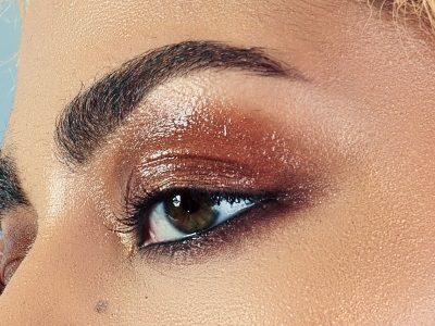 A photograph of a person's eye area with makeup applied