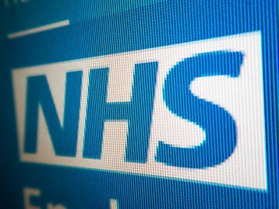NHS logo closeup on computer screen
